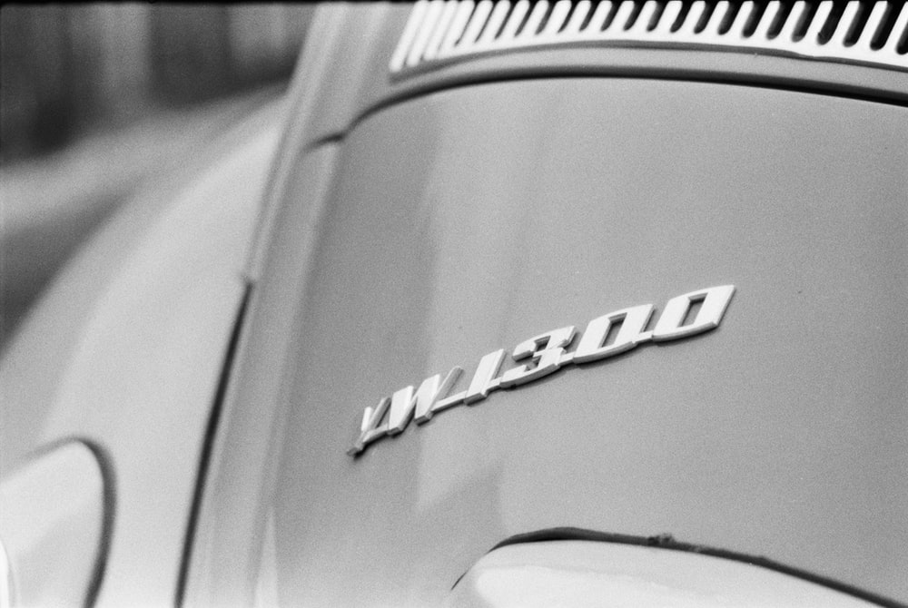 white mercedes benz car in grayscale photography