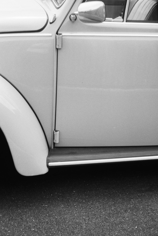 white car on black background