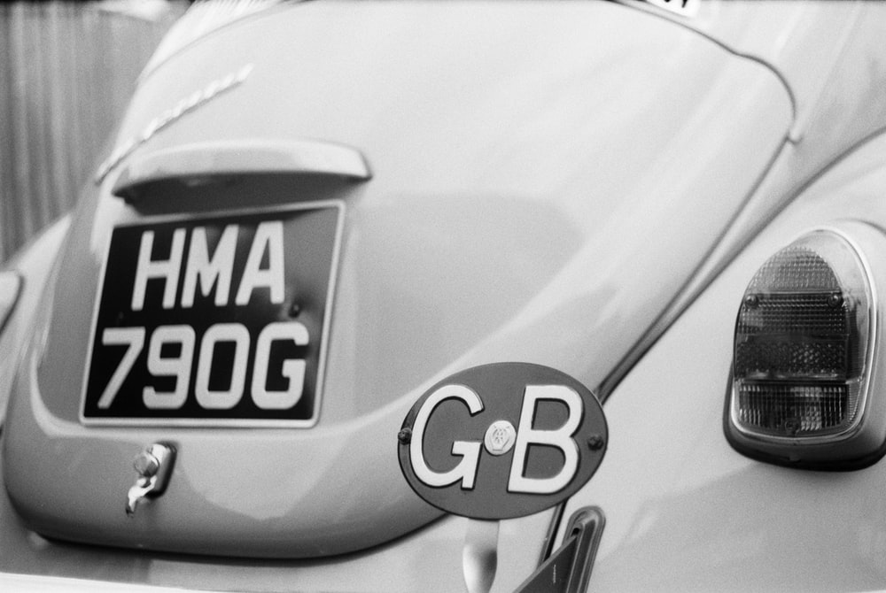 grayscale photo of car license plate