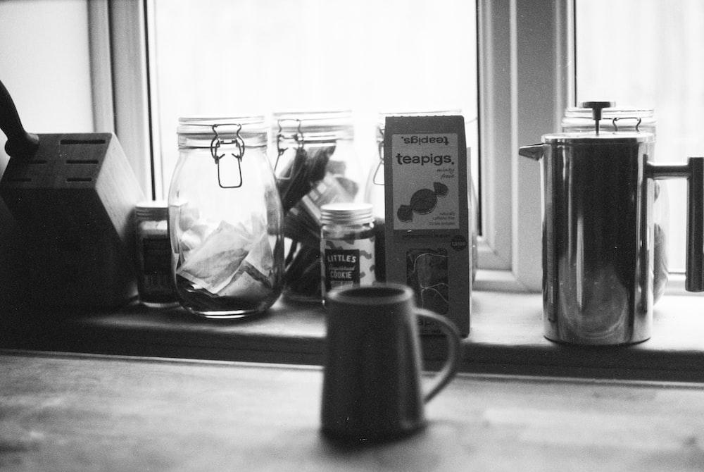 grayscale photo of ceramic mug beside the box