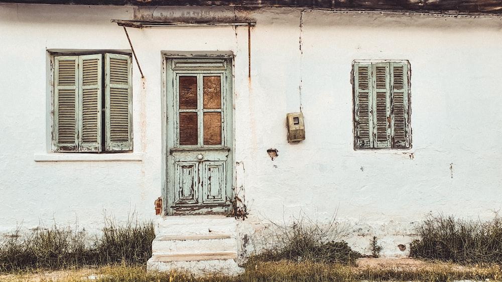 white wooden window with brown wooden door