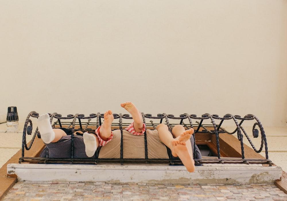 3 women lying on the beach shore