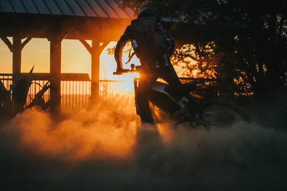 man in black helmet riding motorcycle during daytime