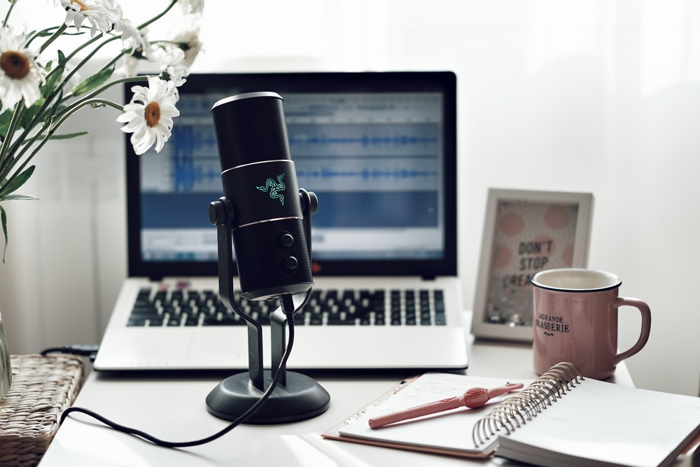black microphone on white paper