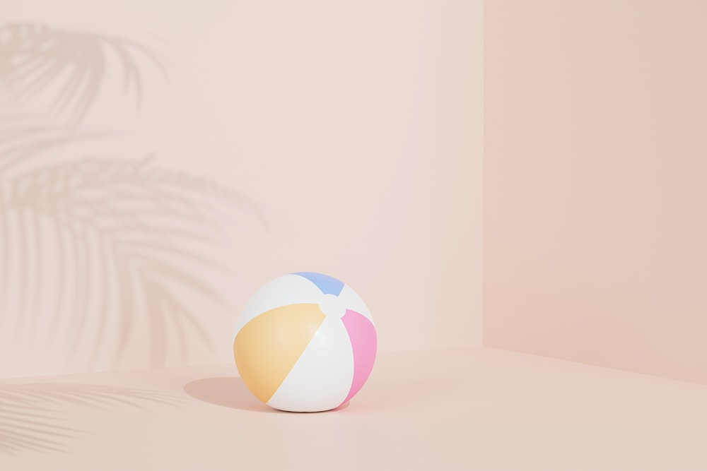 white yellow and blue ball
