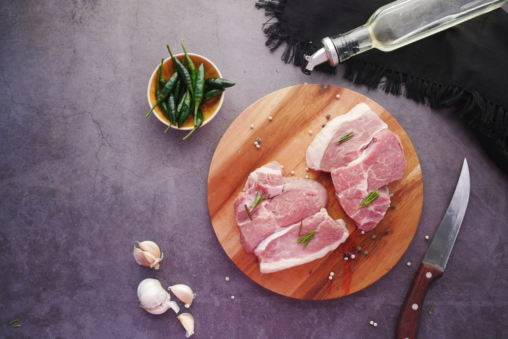 sliced meat on brown wooden chopping board