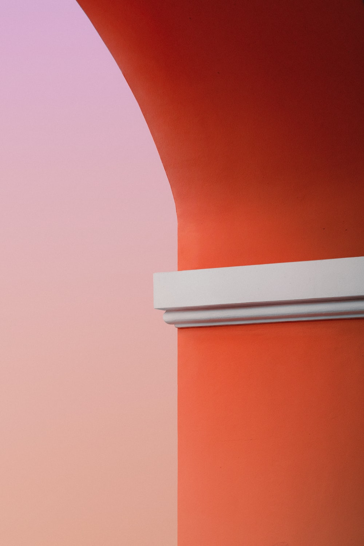 orange and white concrete pillar