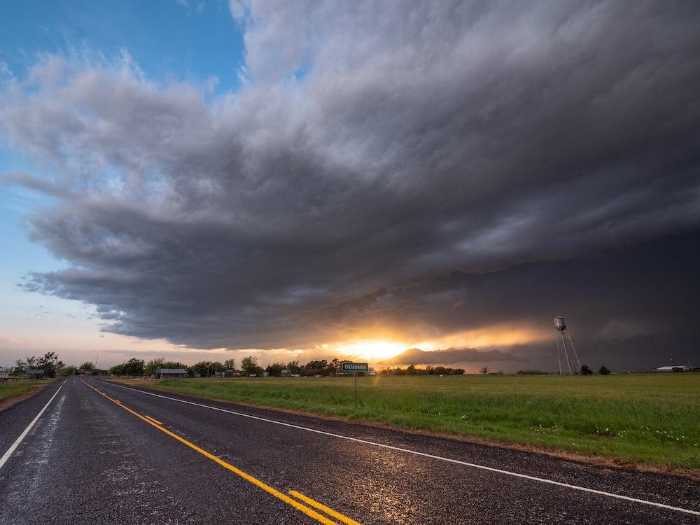 gray concrete road under gray clouds