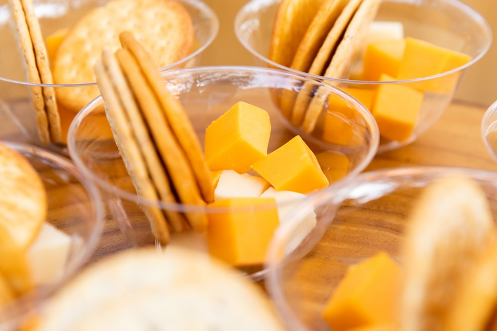 sliced mango in clear glass bowl