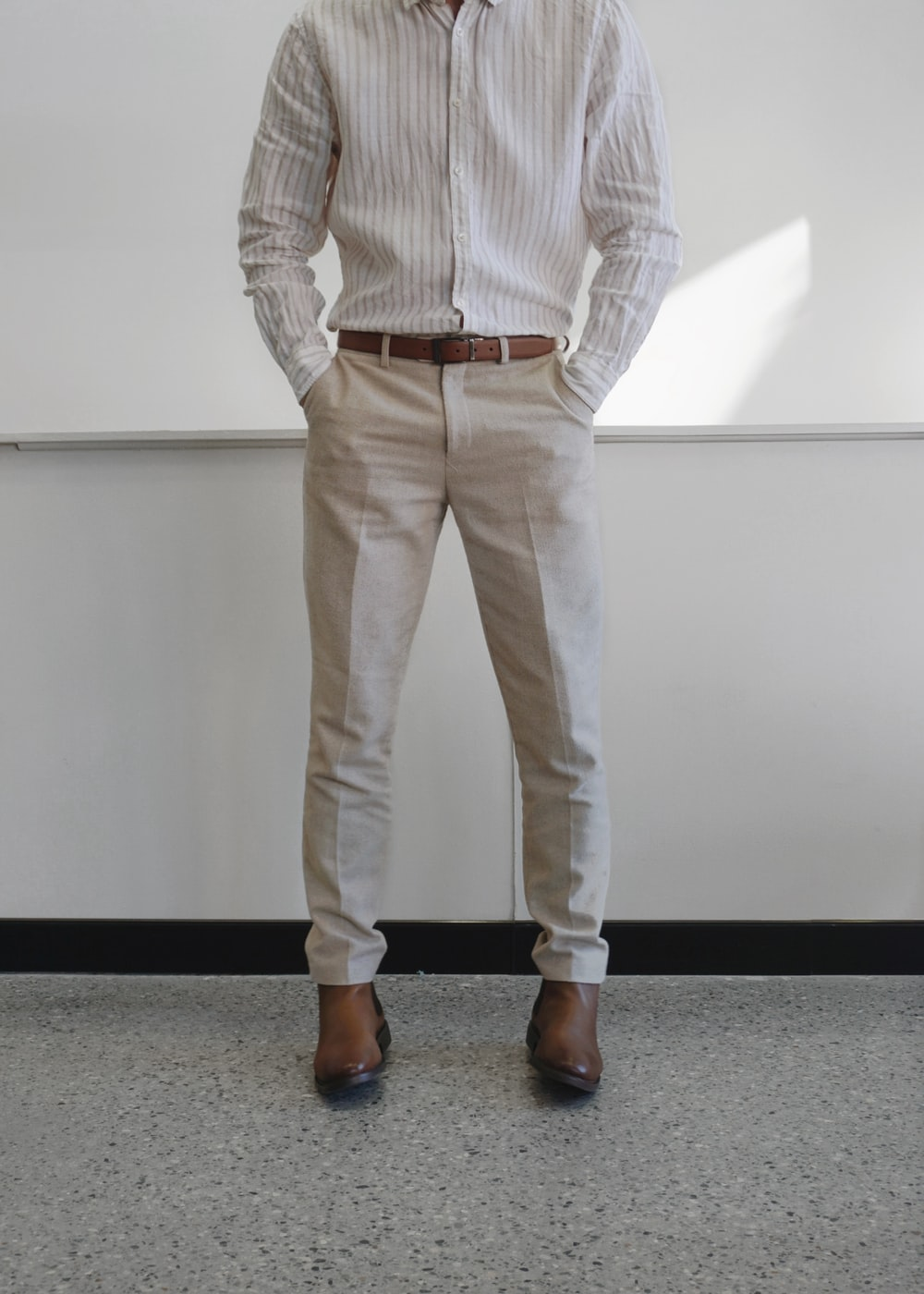 man in white and gray pinstripe dress shirt and white pants