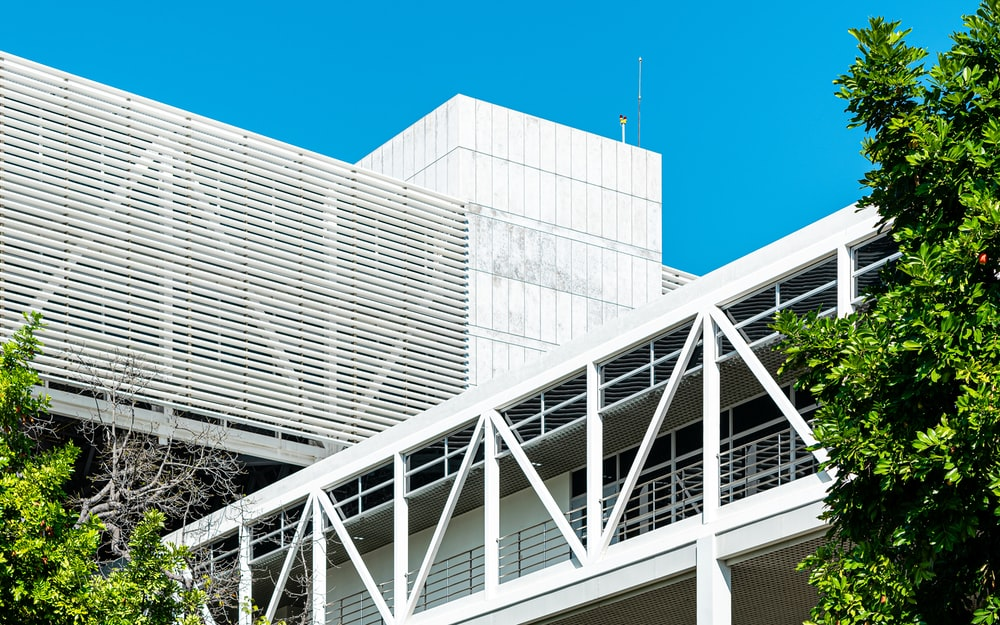 white metal frame near white concrete building during daytime