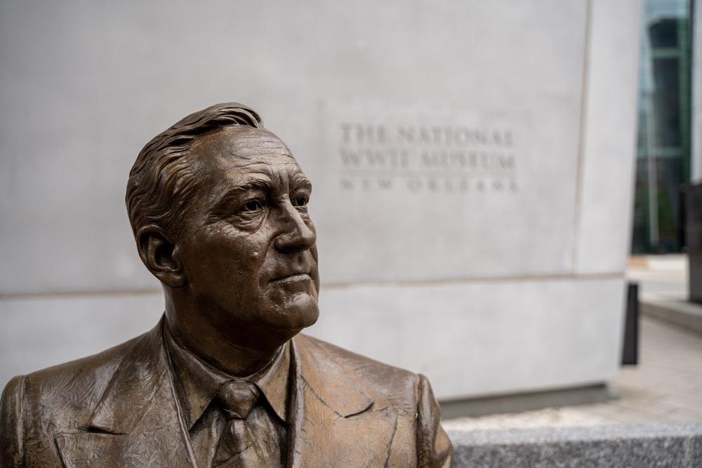 man in suit jacket statue