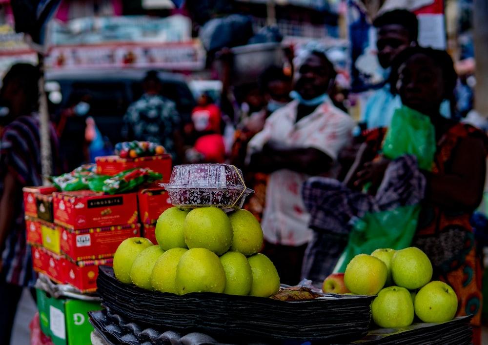 green apples on black plastic basket