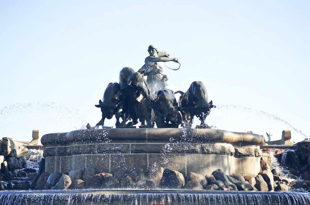 people riding horse statue during daytime
