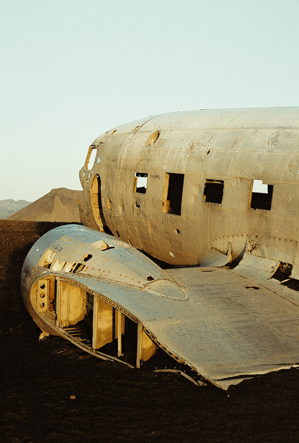 wrecked white and brown airplane