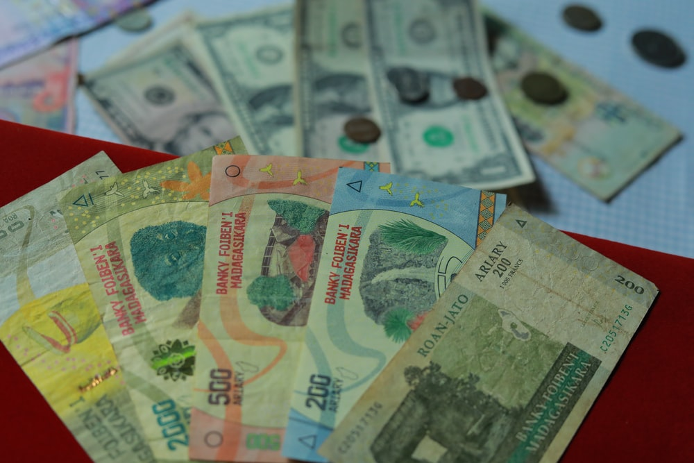 10 and 20 banknotes on red textile