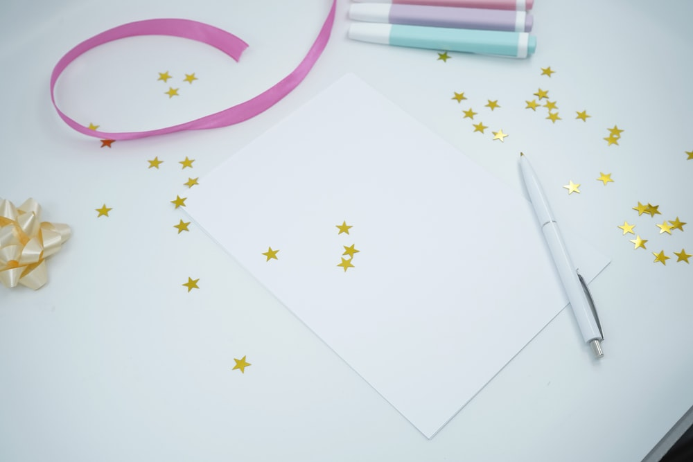 white and pink floral paper