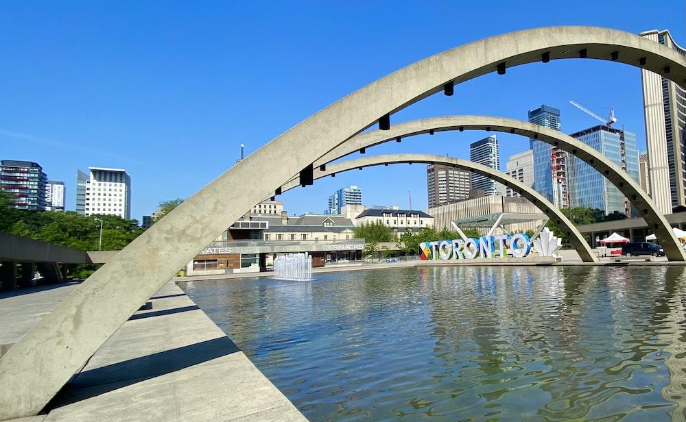 white concrete bridge over river during daytime