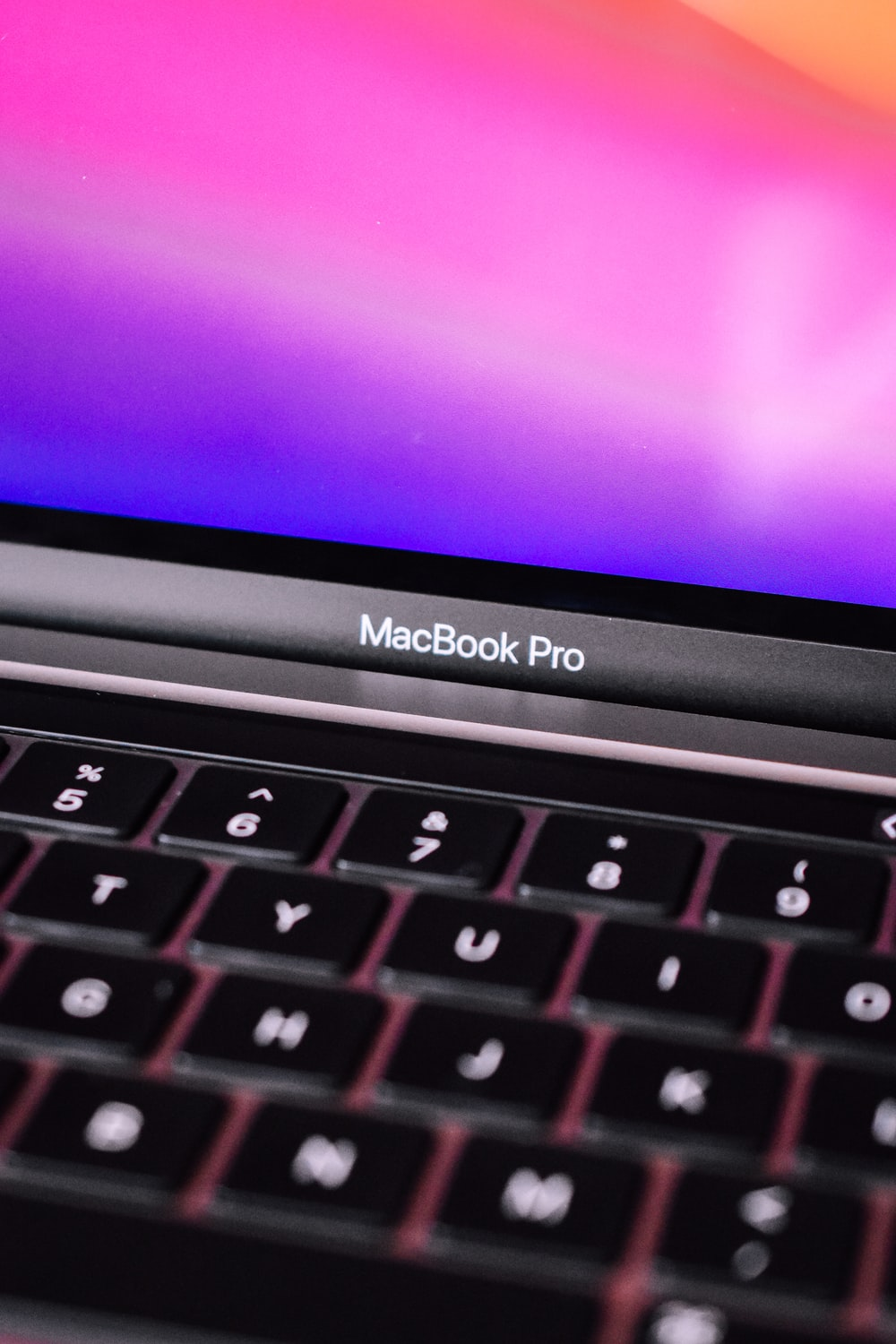 black and gray apple laptop