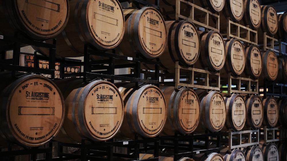 brown wooden barrels on rack