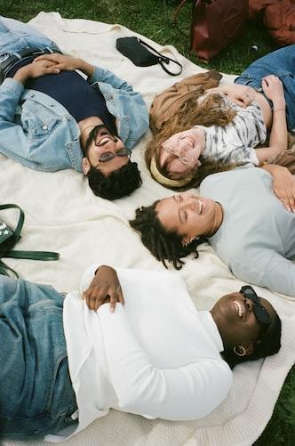 people on picnic blanket