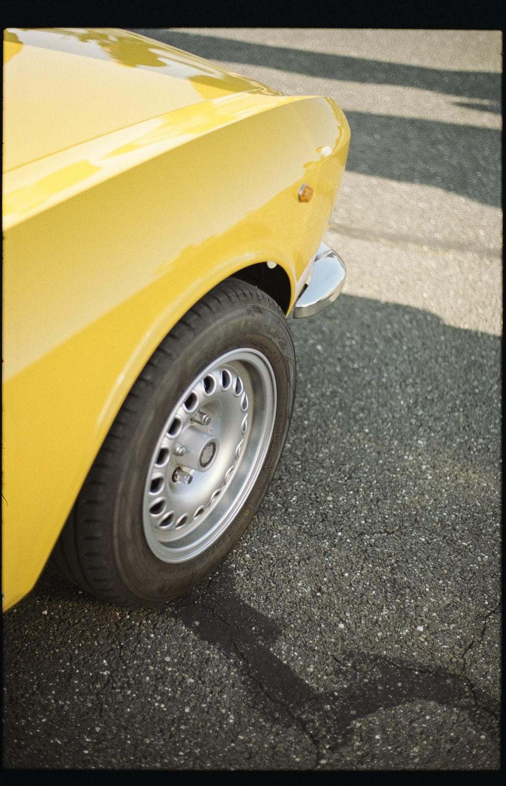 yellow car with gray wheel