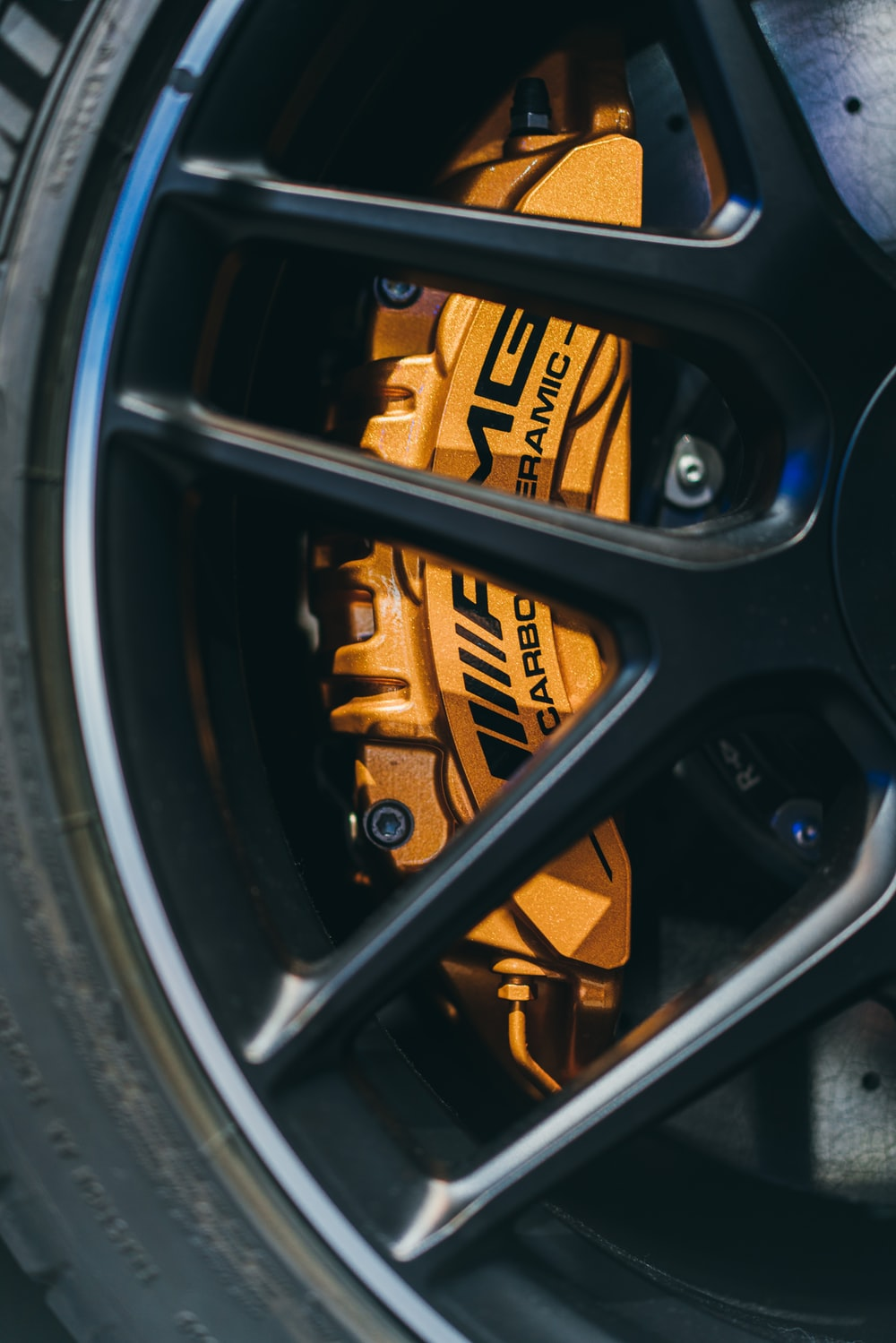 black and yellow wheel with tire