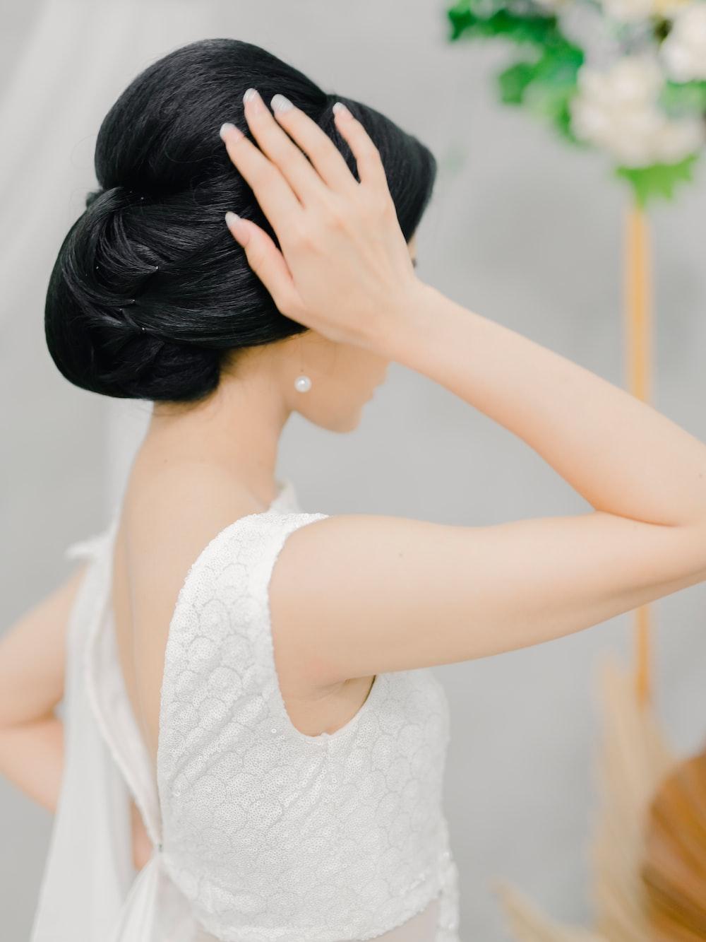 woman in white tank top