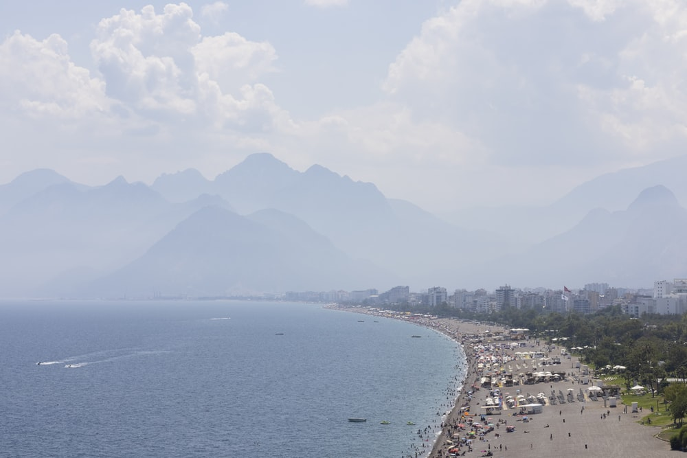 aerial view of sea and mountain during daytime