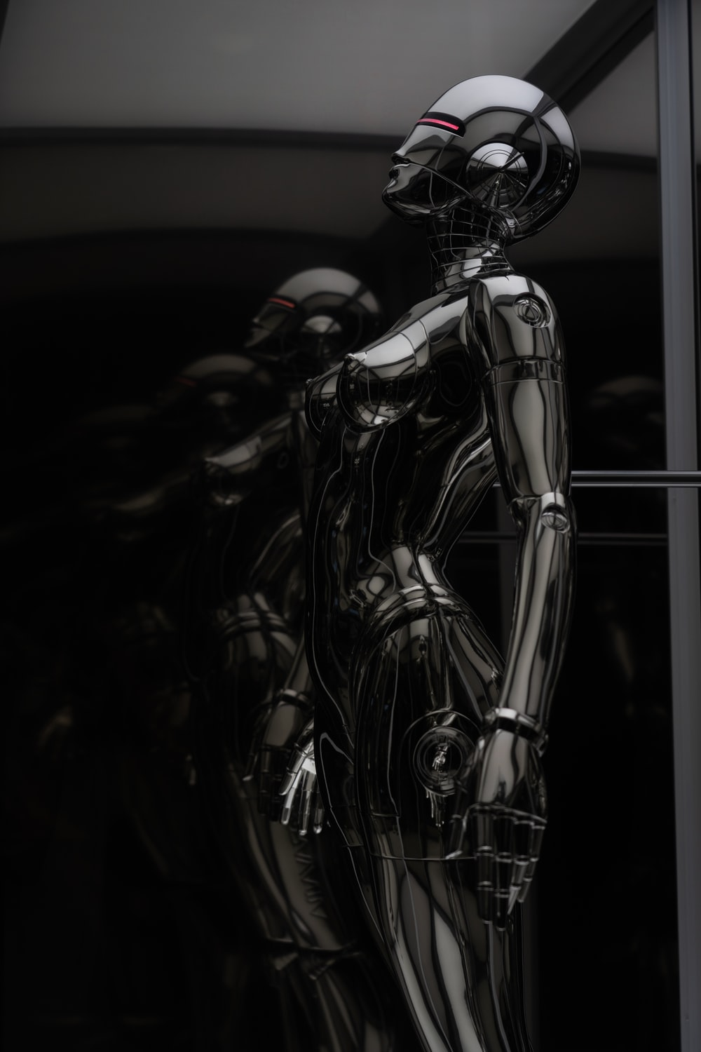 stainless steel robot toy in close up photography