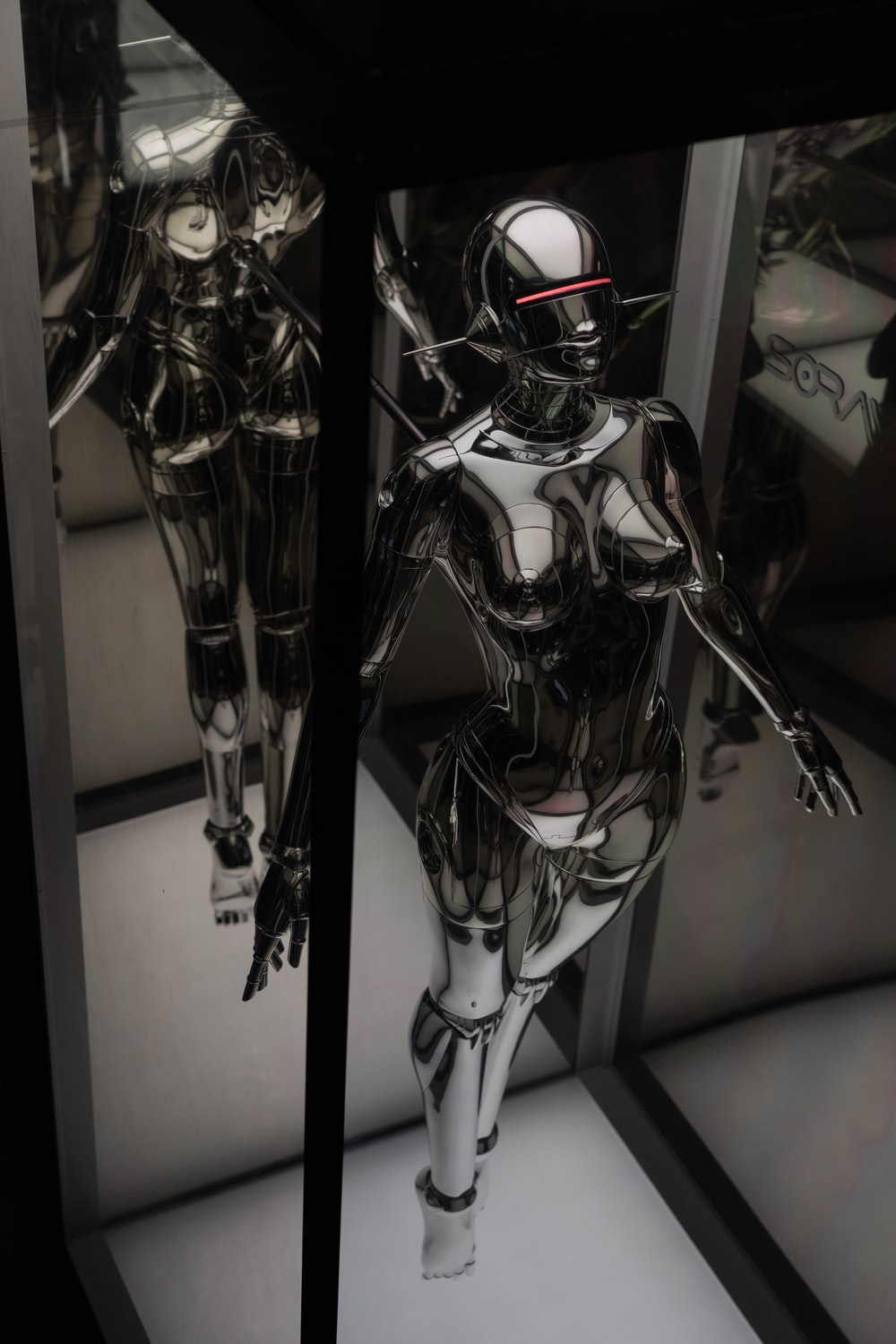 black and silver robot action figure