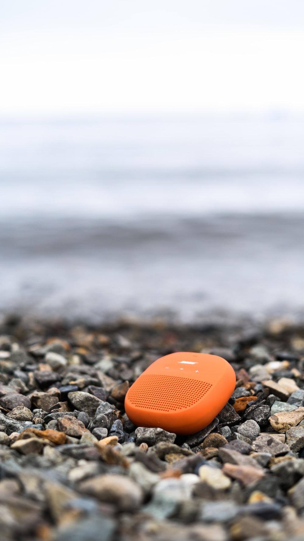 orange heart on rocky shore during daytime