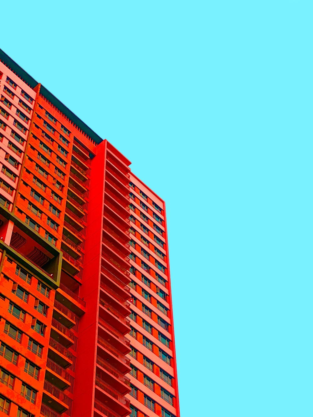 red concrete building under blue sky during daytime