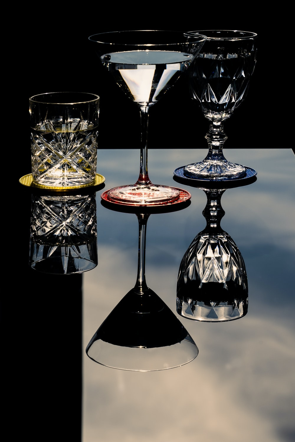 2 clear wine glasses with red liquid