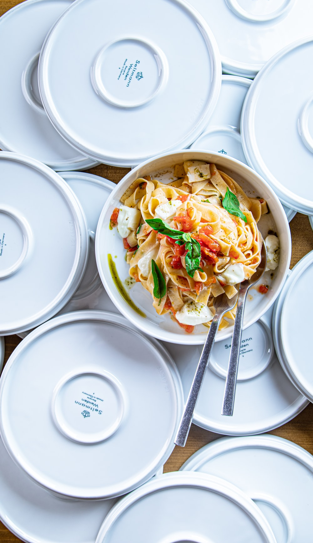 white ceramic bowl with chopsticks