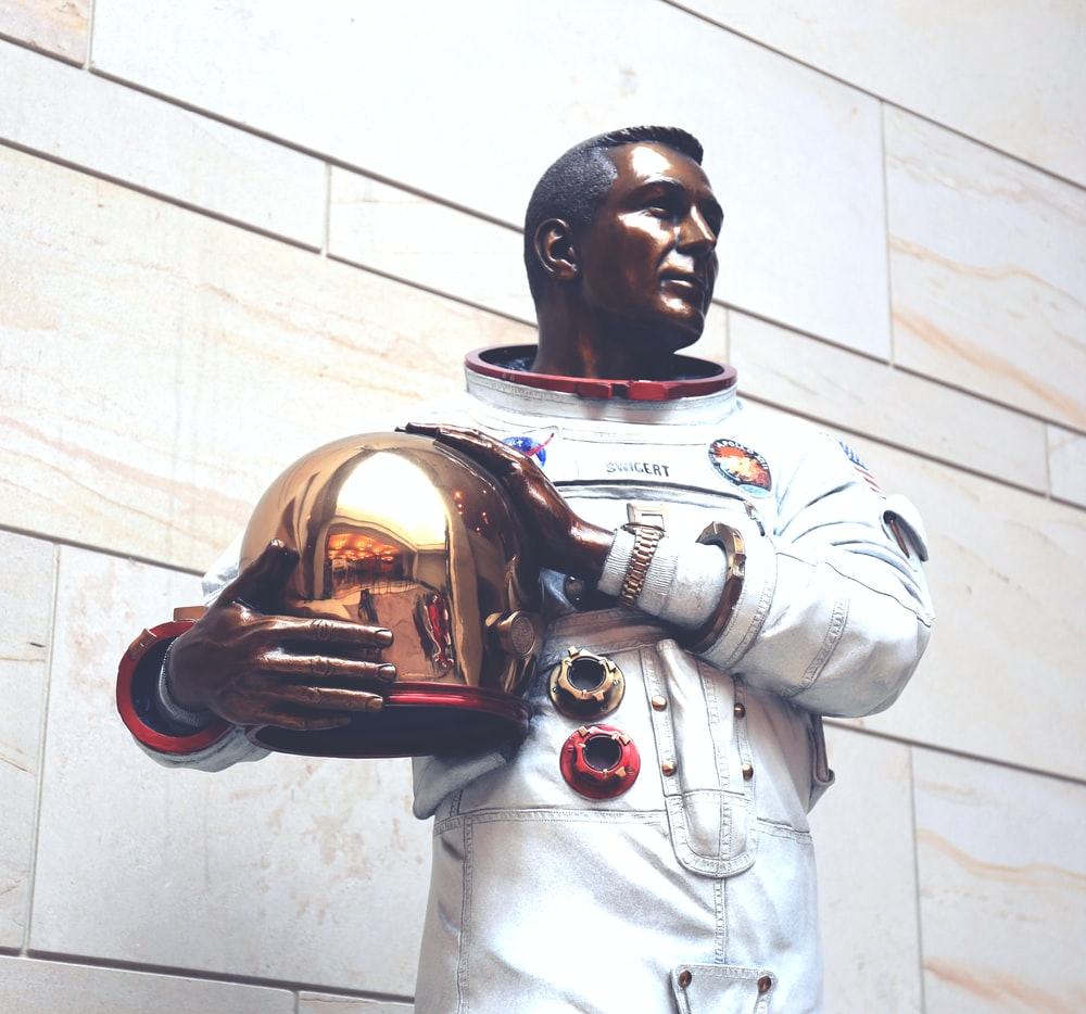 man in white and red power ranger costume holding brown football
