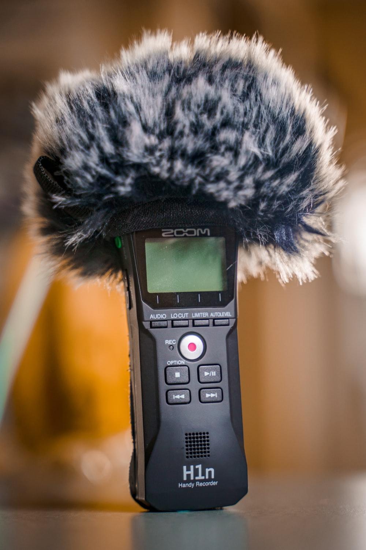 black panasonic wireless phone on white textile