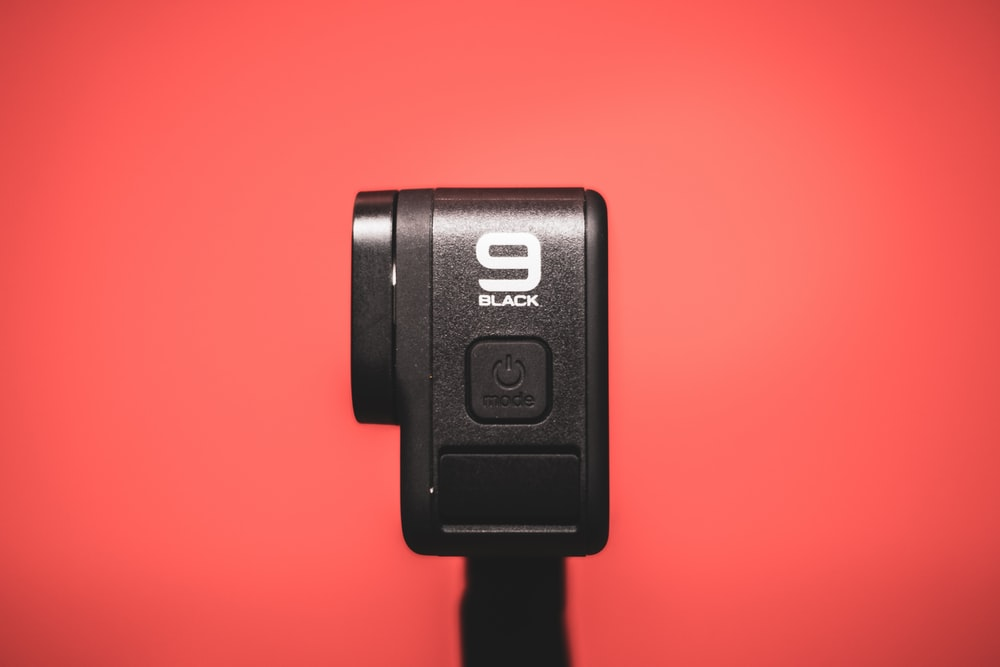 black power bank on red surface