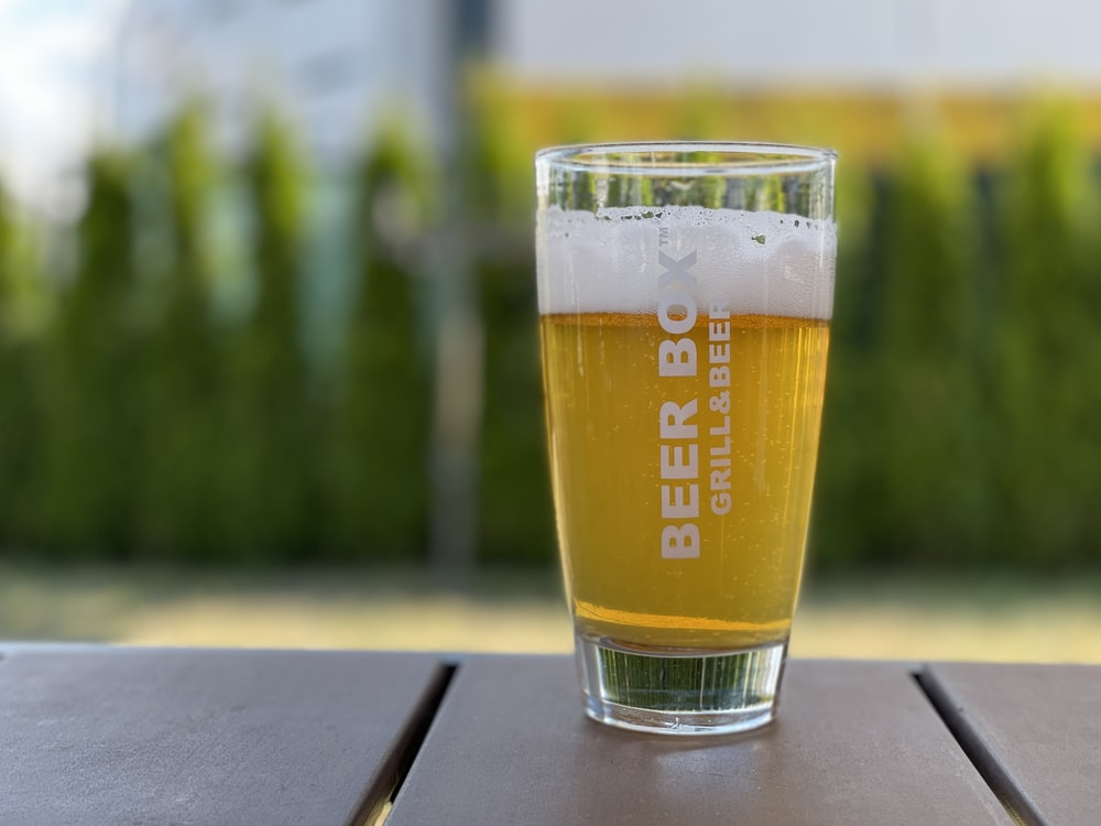 clear drinking glass with beer on table