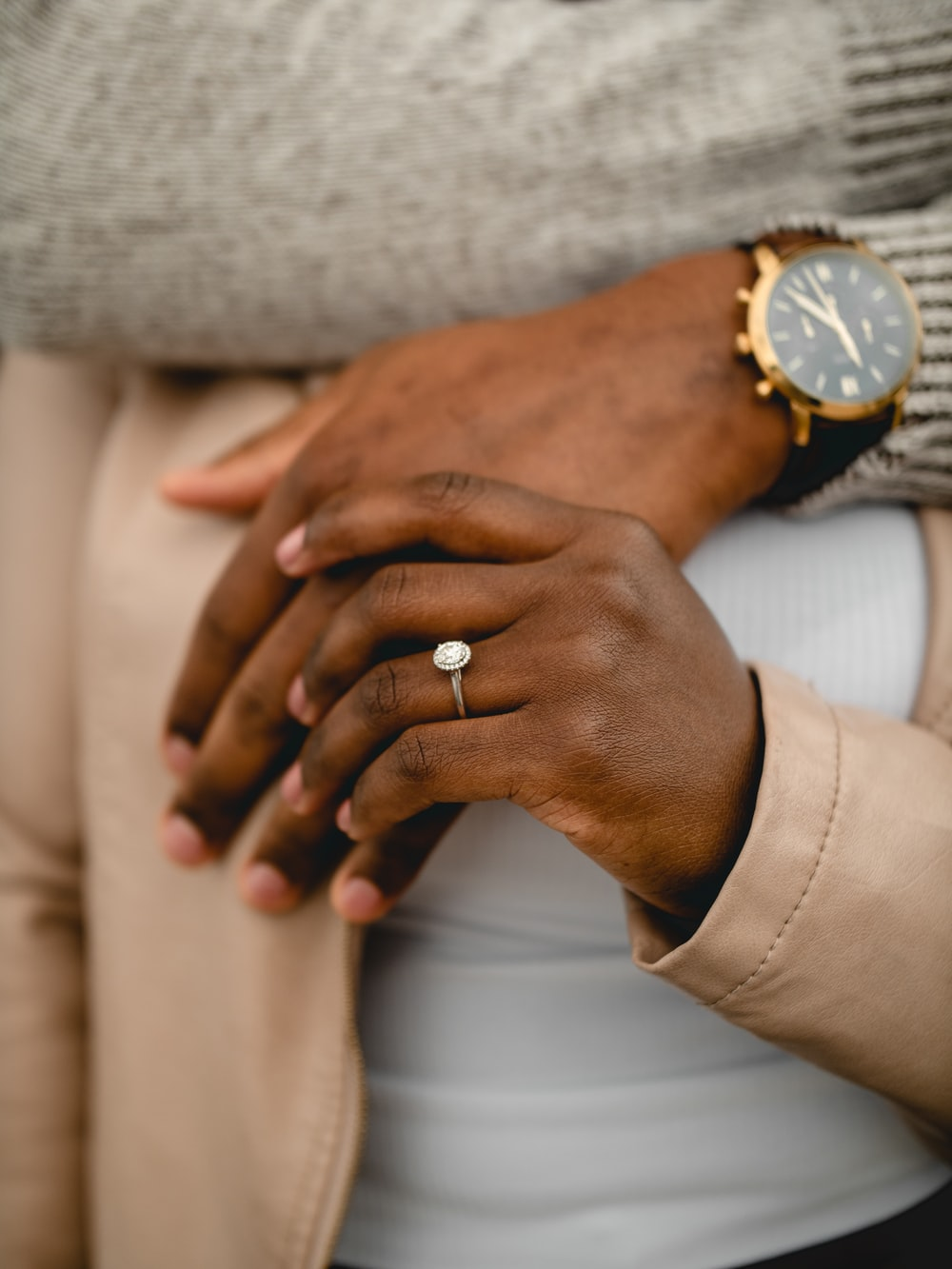 person wearing gold ring and silver ring