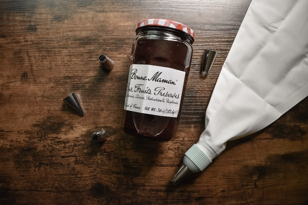 brown glass jar on brown wooden table