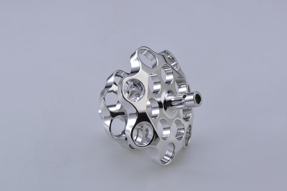 silver and black round accessory