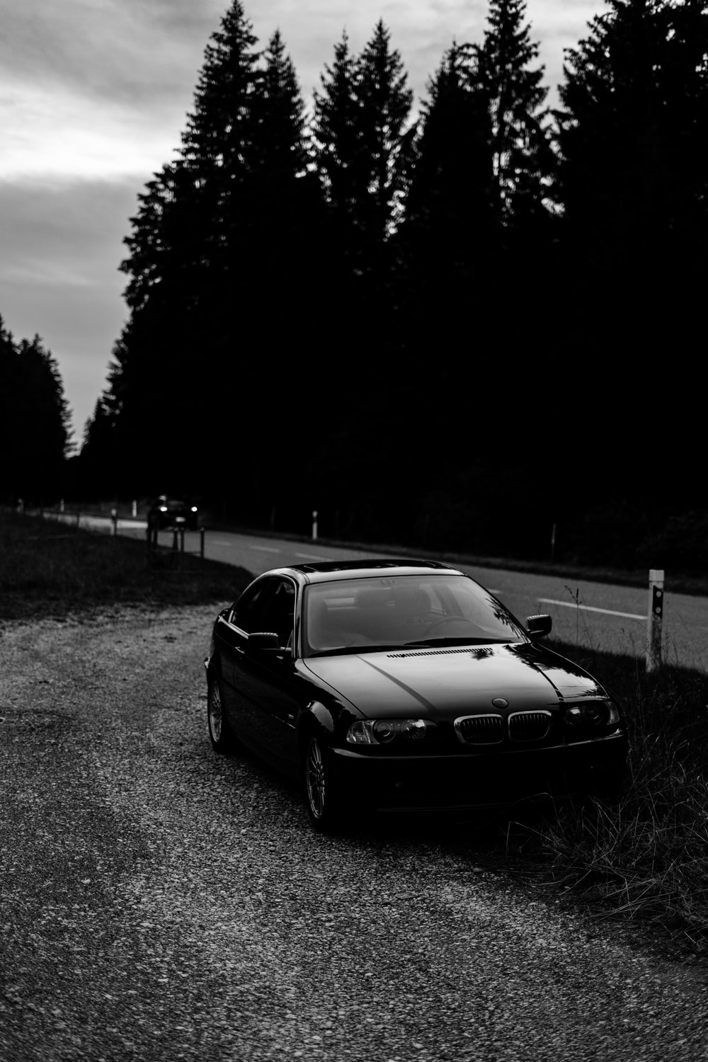 grayscale photo of bmw m 3 coupe on road
