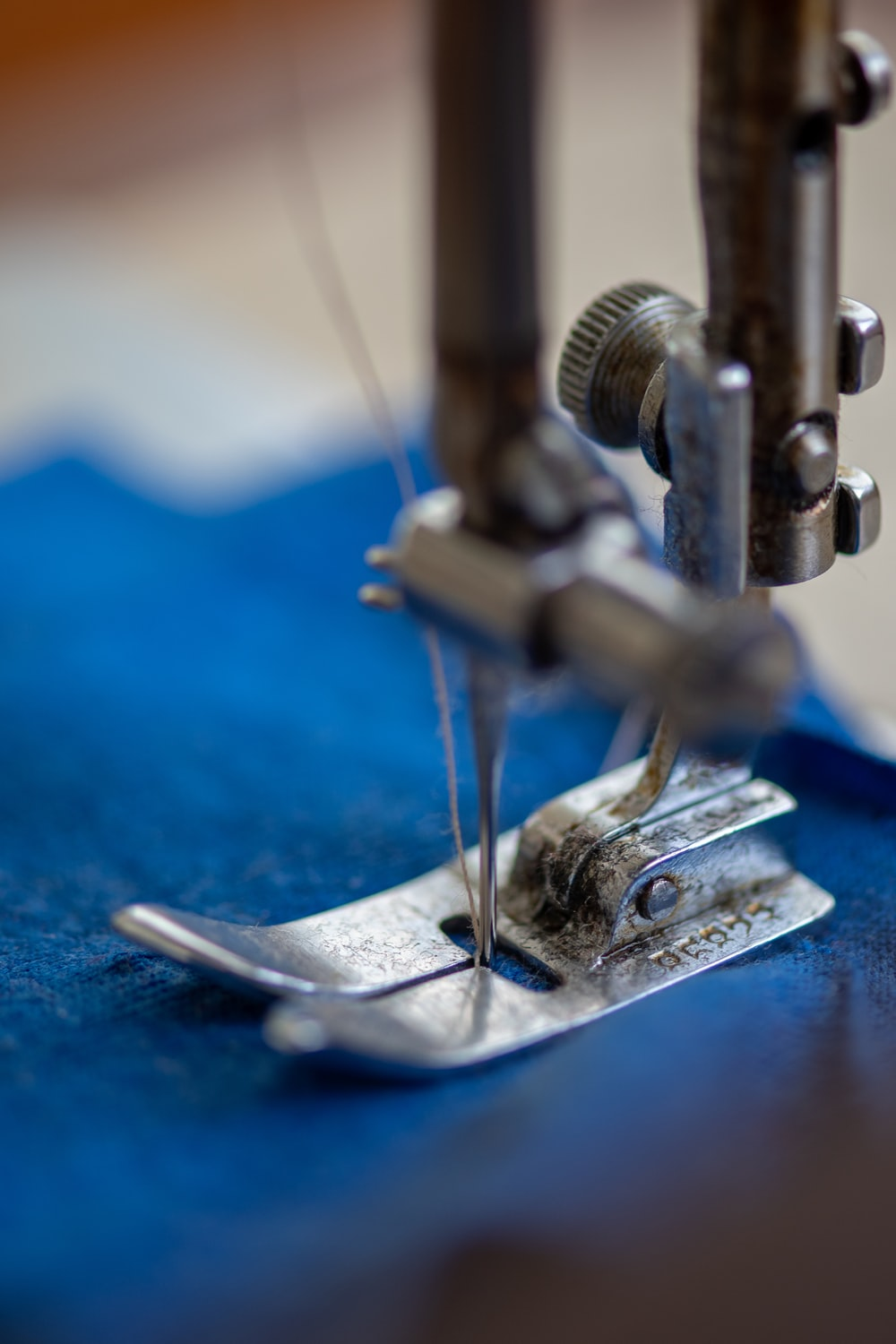 blue and silver sewing machine