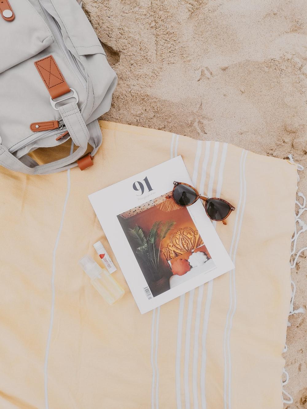 white leather handbag on white textile