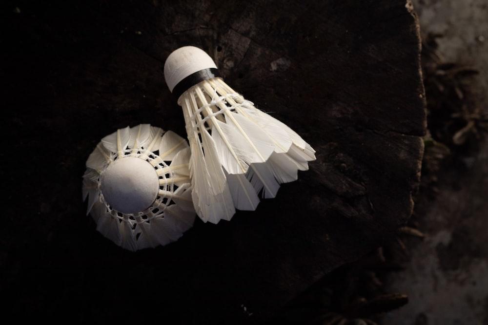 white paper lantern on black surface