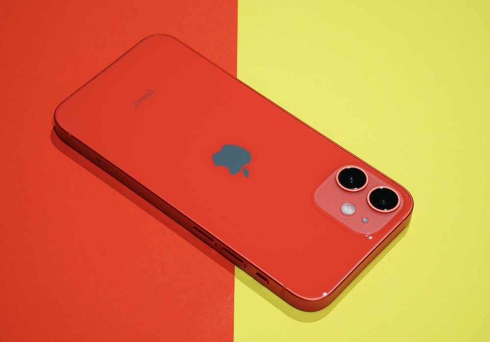 red iphone 7 plus on red table