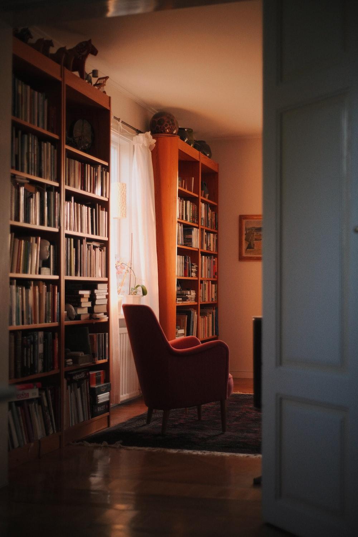 brown wooden shelf near white wooden door