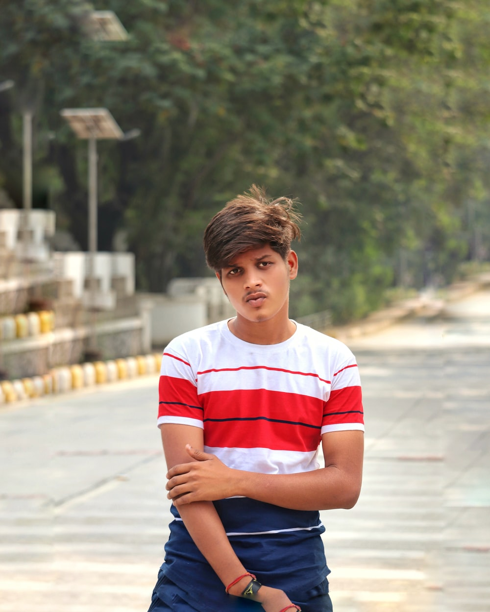 boy in red and white striped crew neck t-shirt and blue denim shorts sitting on on on on on