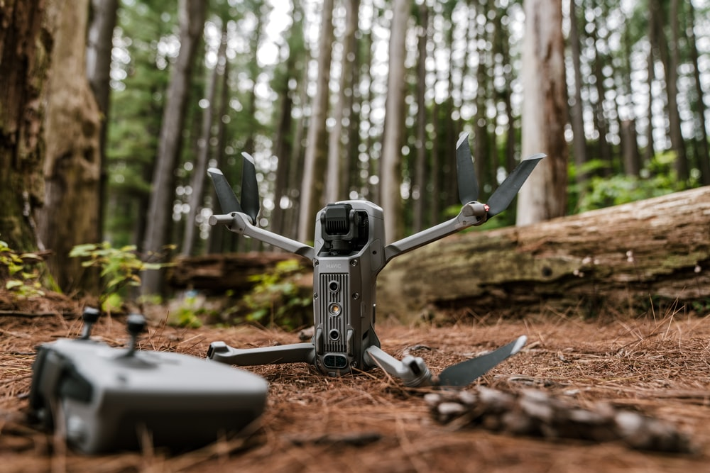 gray and black drone on brown soil